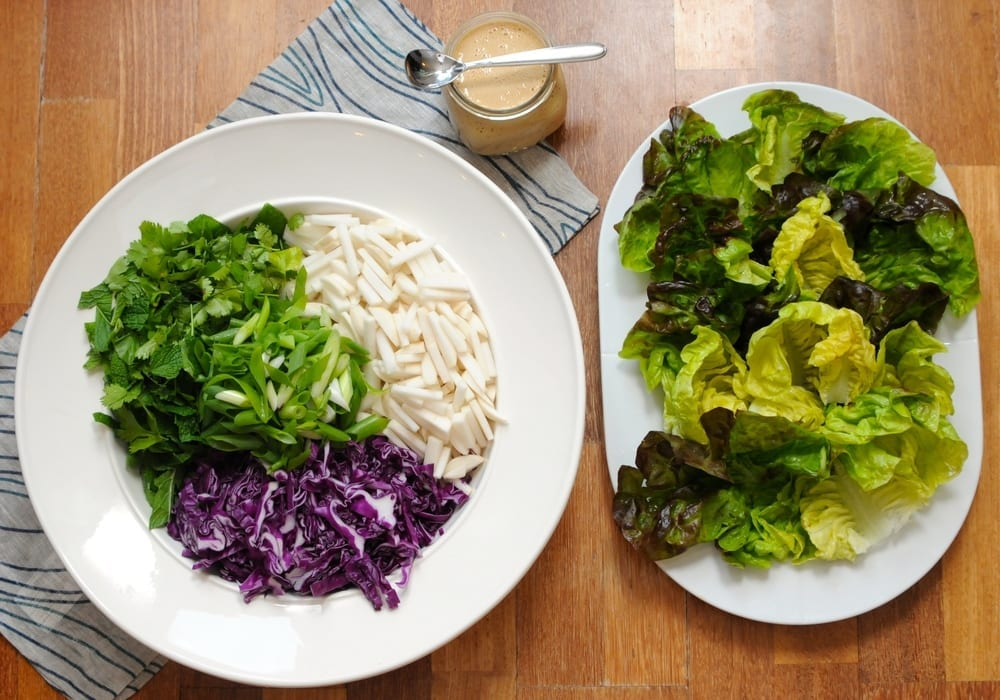 Image of Turnip and Herb Salad Lettuce Wraps with Peanut Coconut Satay Drizzle Sauce
