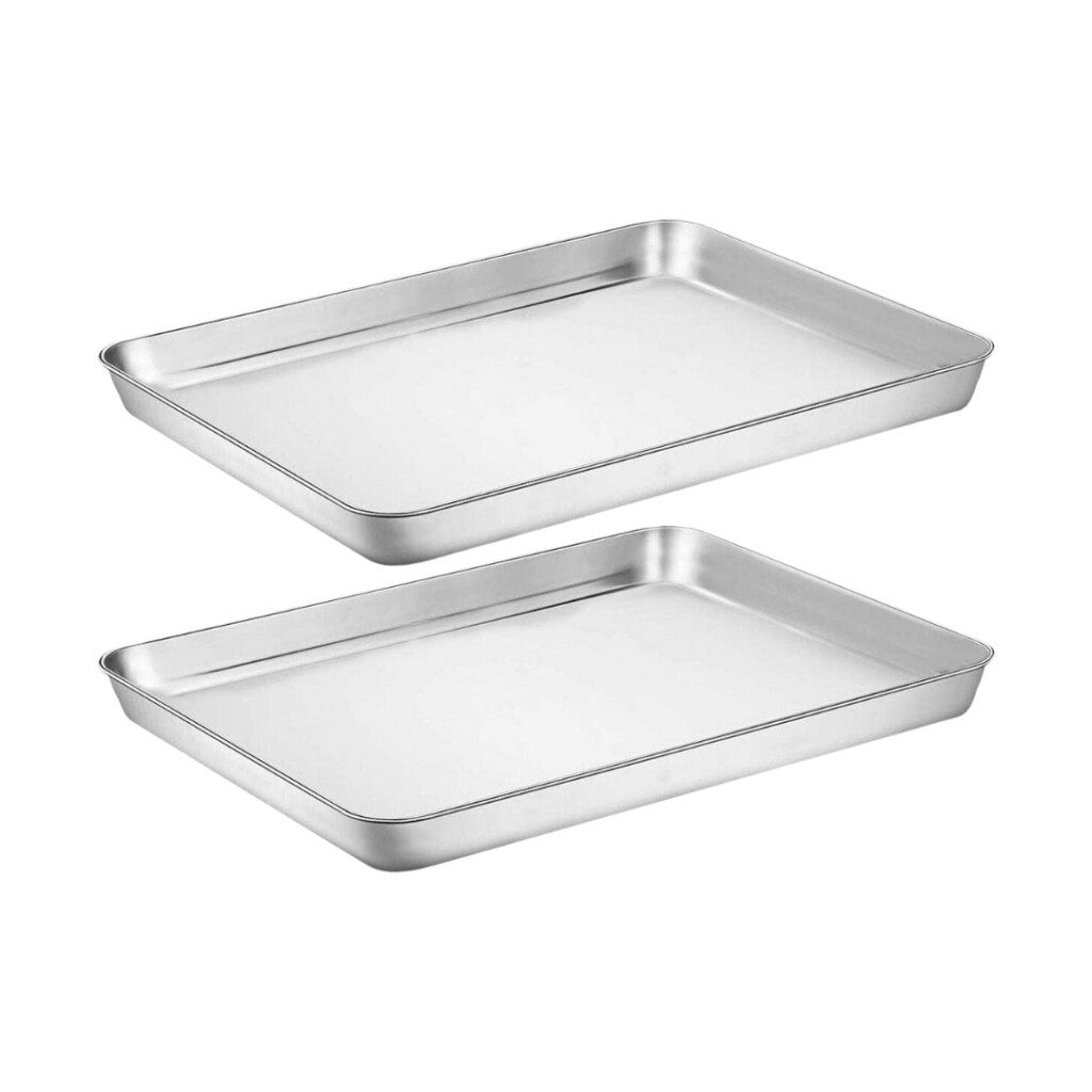 two stainless steel baking sheet pans on white background