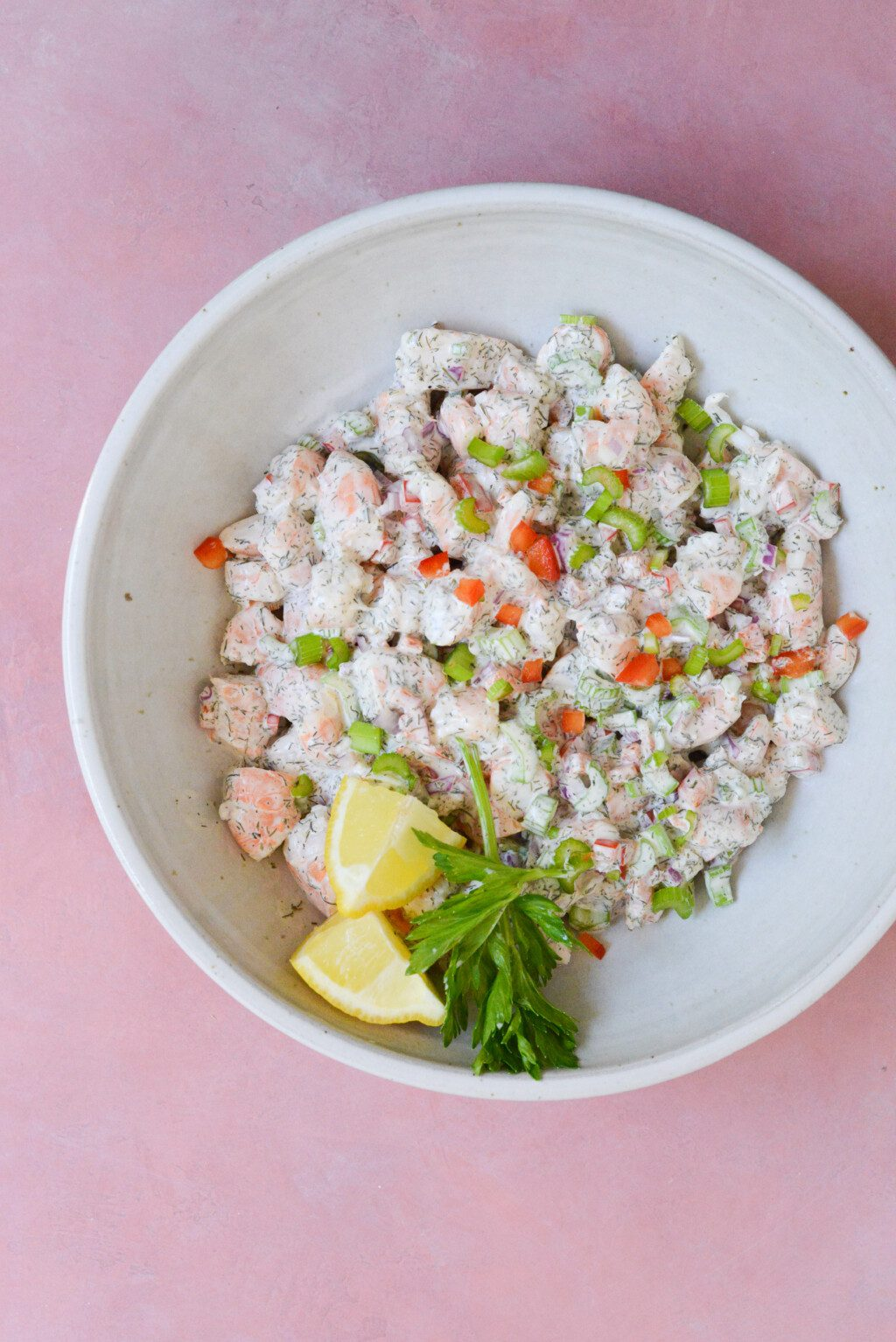 top down view of shrimp salad in a white bowl