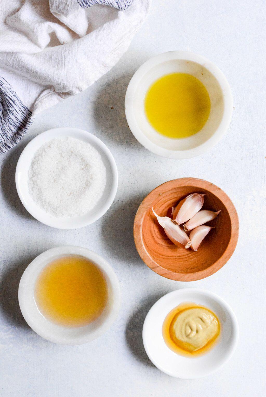 ingredients for apple cider vinaigrette on a white table