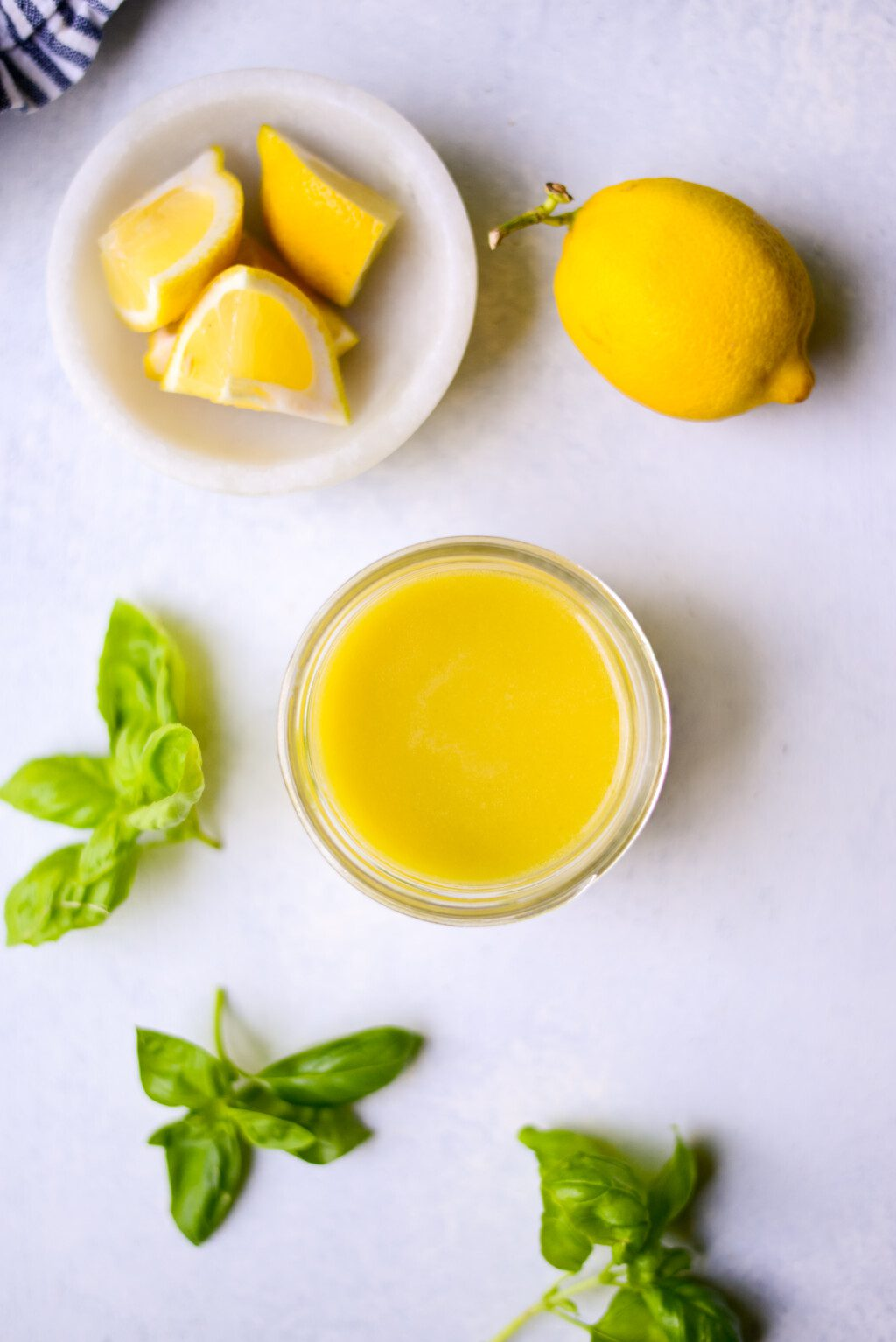 top down view of ingredients for a lemon salad dressing