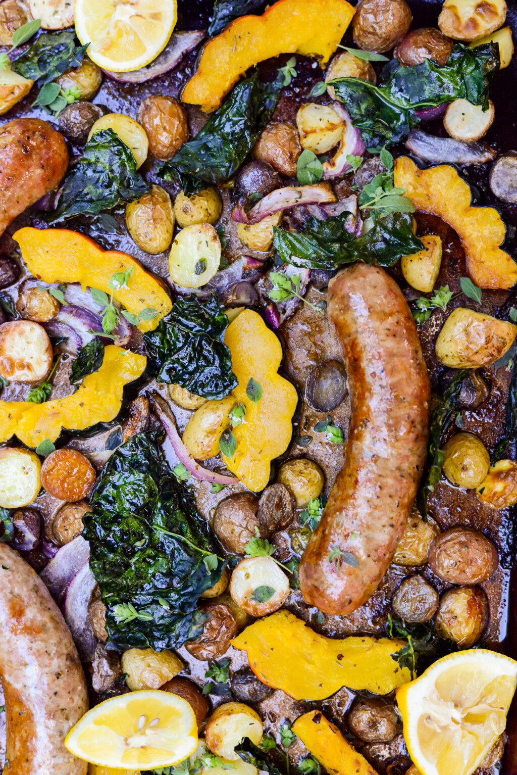 top down view of a sheet pan dinner with roasted acorn squash and sausager